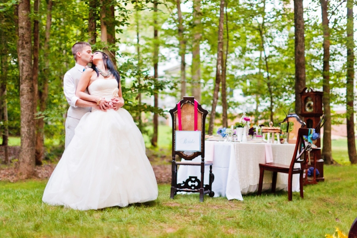 alice-in-wonderland-tea-party-wedding-inspiration-bride-and-groom-with-tablescape
