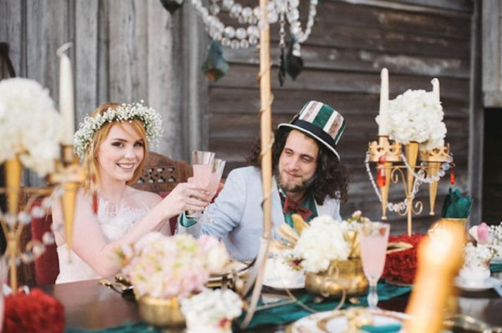 alice_in_wonderland_bride_and_groom_at_table__full