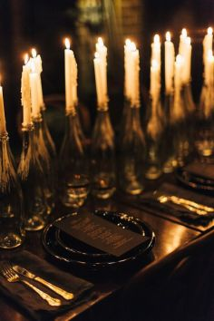 black-on-black-table-setting-with-candle-centerpiece-e28093-shared-on-lane