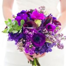 https://www.theknot.com/real-weddings/purple-bridal-bouquet-photo-32